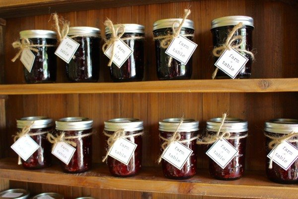 Rows of jam jars on shelves at Farm + Table