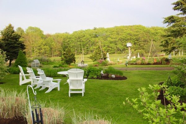 adirondack chairs on a lovely green lawn