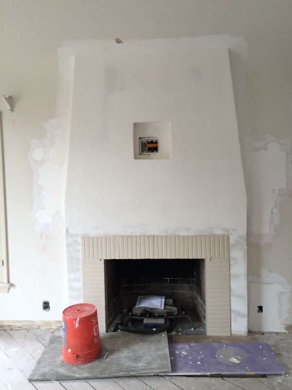 Notice the 3-D upper fireplace. It used to b e just a flat wall. The insert in the middle is for the TV plugs.