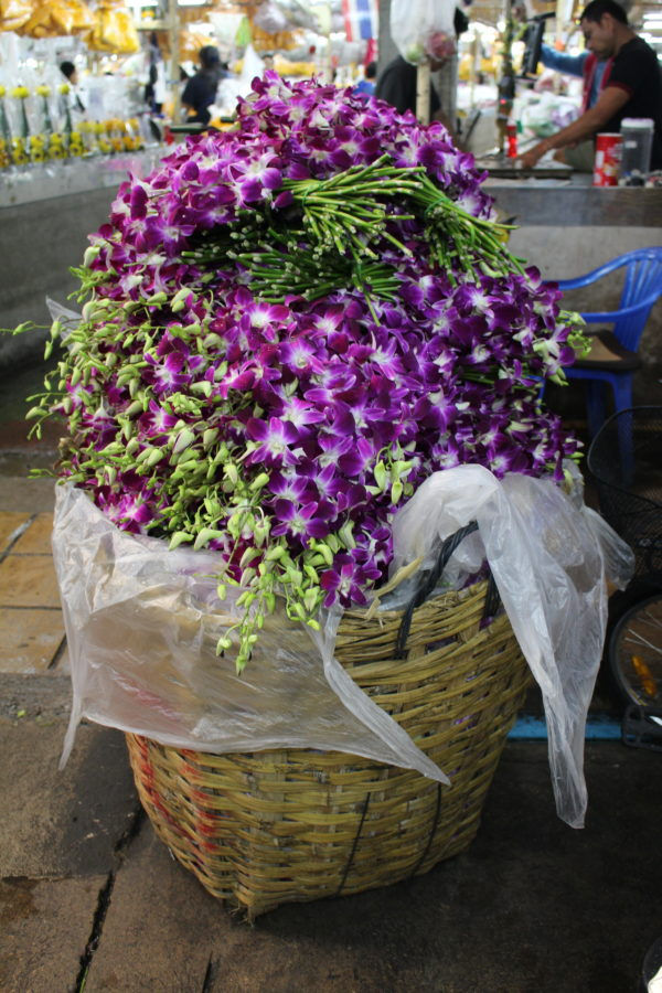 Piles and piles of orchids at the flower market are just one of the ten reasons to visit Thailand.