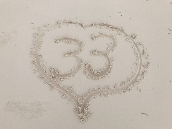 The number 33 written in the white sand of the beach at the Andaz Mayakoba Resort.