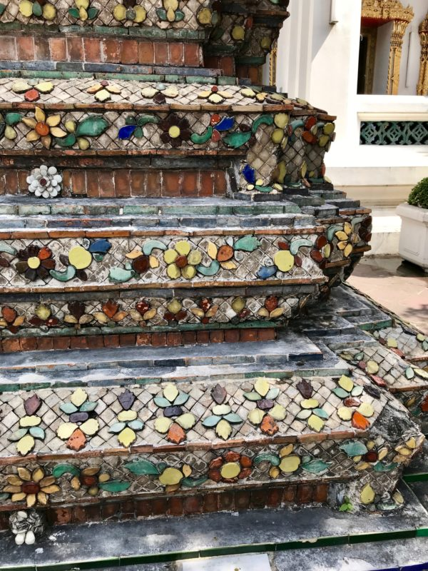 Ten reasons to visit Thailand - seeing the ancient tile up close on a temple.