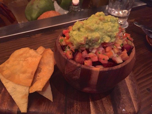 Rice and beans with pork belly and guacamole