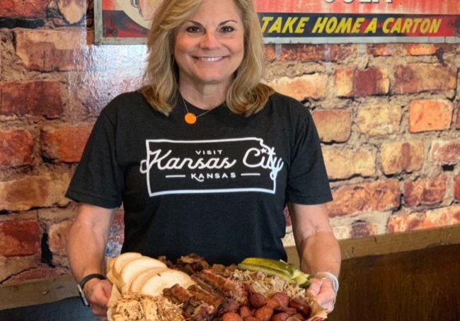 holding a tray full of bbq in Kansas City Kansasa